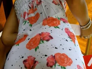 An inquiring camera looks under a white dress with