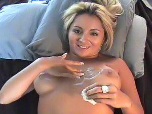Girlfriend empties full condom on her tits