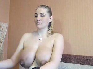 Blonde milf with large breasts rubs her