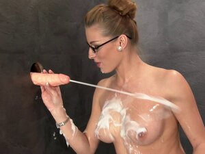 In a gloryhole this glasses wearing babe fucks a