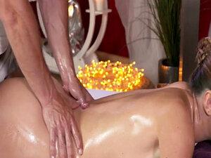 Curved brunette banged by masseur in massage room