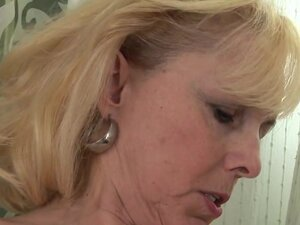 Blonde milf is fucked with a dildo by her sexy
