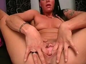 Carmen stretches her tight pussy with a humongous