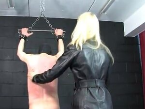 Blonde mistress dominates two male slaves