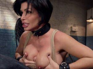 Busty MILF slave gets titsjob threesome