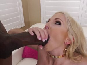 Busty barbie doll MILF sucking a monster cock
