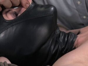 Hooded sub groped all over by two doms