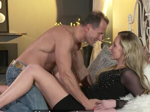 Passionate lovemaking on the bed with a cumshot