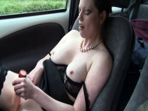 British slut Holly plays with herself in the car