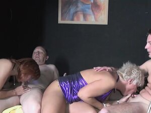A couple of swinger ladies go down and bend over