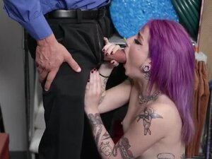 Pinked haired Val Steele with pierced nipples