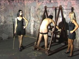 Taste it - hard caning by 2 mistresses