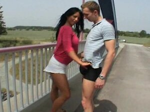 Hot brunette fucks on a top of a bridge - Public