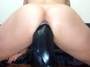 Sarah fucks a gargantuan dildo in her greedy