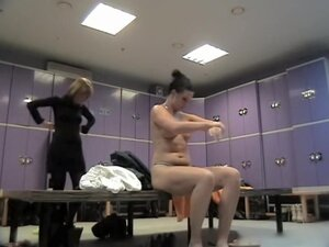 Naked bimbo is oiling her body on dressing room