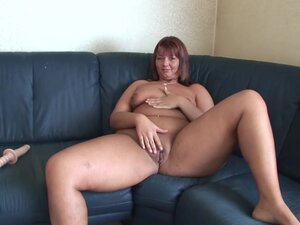 Busty Redheaded Euro MILF toys both holes on her