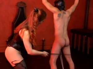 Restrained slave gets spanked by mistress in