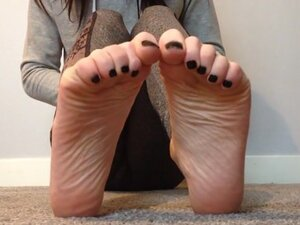 Soles and toes feet tease with painted toes