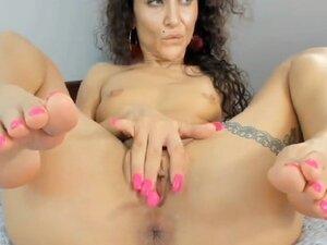 Wet girl masturbating her shaved pussy on webcam