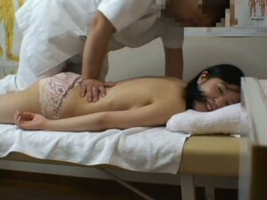 Girl lying on back letting man look inside pussy