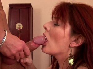 Mature redhead fucked by younger guy