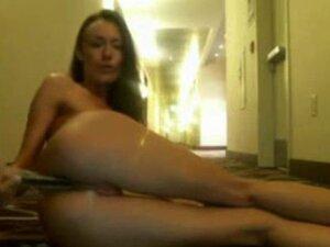 Teen babe masturbates in hotel hallway