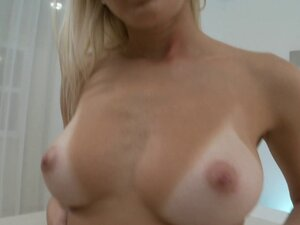Busty babe with the best tan lines fucks a toy