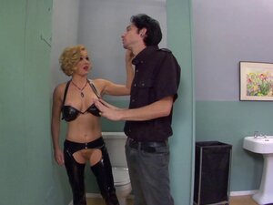 A mistress in leather makes her slave eat her ass