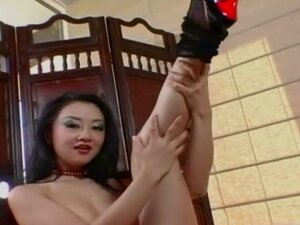 Asian masturbates in a red corset and stockings