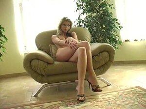 Sensuous model in high heels enjoys an erotic solo