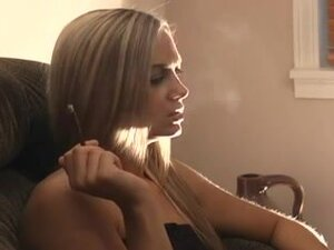 Sexy teen blonde is smoking a cigarette, Pretty