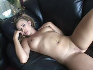 Chick Demi is lying on the bed and masturbating