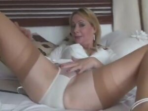 Busty milf in retro underwear and stockings