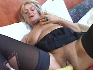 Voluptuous mature laid in her bedroom