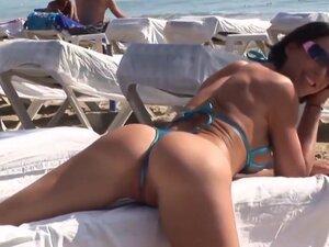 Hot brunette milf posing in sexy bikini on public