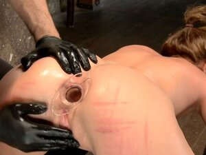 Hogtied gagged brunette is anal plugged