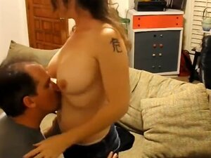 Husband banging his wife in the living room