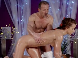 Tanned oiled body babe rides masseur