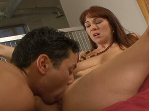 Redhead mature whore Rayveness in leopard lingerie