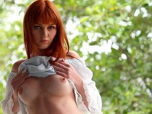 Redhead fox undresses her stunning slender body