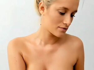 Young blonde girl with sexy big tits playing with