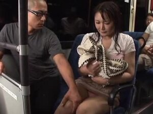 Busty Japanese milf gives a titjob to a stranger
