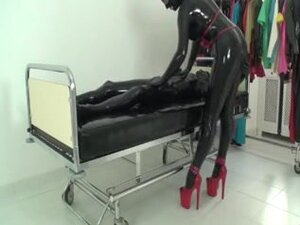 Rubber xxx sex video with latex whore with red
