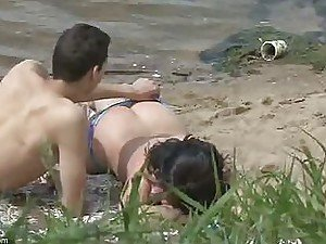 A voyeur spots a cute couple fooling around in the