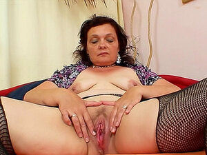 Chubby mature masturbates steamy pussy