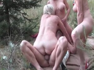 Mature excited sluts having a foursome outdoor