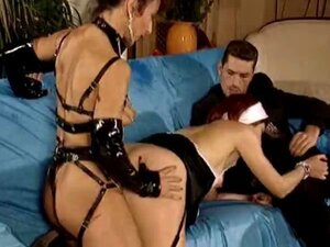 Mistress in strapon and fist action
