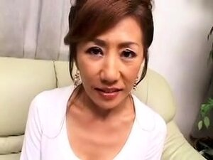 Buxom Japanese mom has a young cock satisfying her