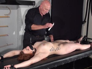 Amateur slave Louise in dungeon rack bondage and