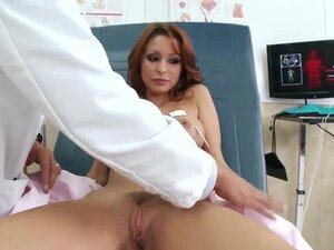 Doctor Marco Banderas inspects Monique Alexander's
